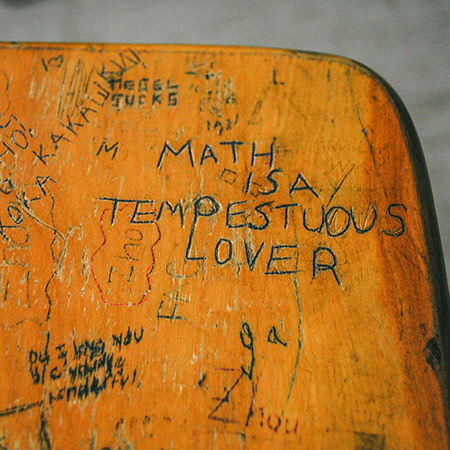 A chair with graffiti on it