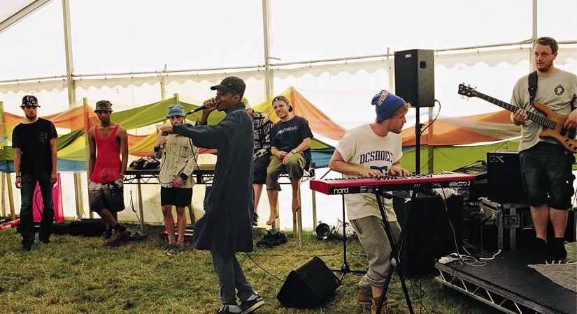 A young band performing at the Brain Child Festival - lead singer, pianist and a guitarist