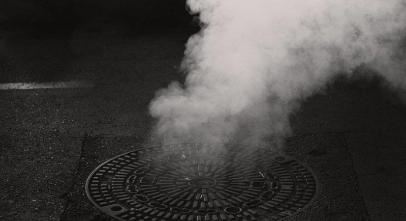 A drain with smoke coming out