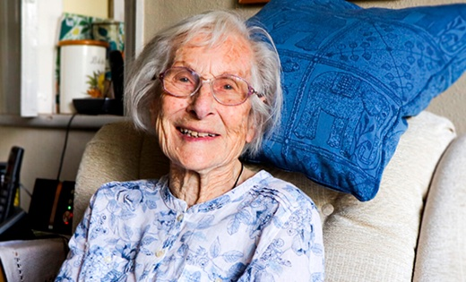 Centenarian Betty Romar sits in her armchair