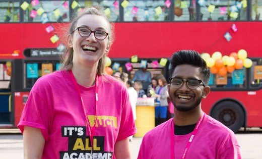 Two pupils at UCL volunteering for the It's All Academic campaign, smiling happily at the camera