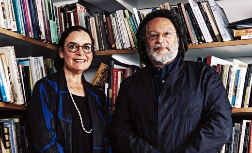 Professors Tamar Garb and Paul Gilroy of UCL stand together next to bookshelves